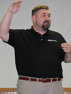 Top Indiana Income Property Management business owner in REIA shirt at REIA Property Investors meetings